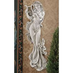 Infuse your space with inspiration with the Design Toscano Musical Muse Wall Sculpture. Although she is cast in a solidly durable material with a stone finish, her robes appear to float about her. Metal Wall Sculpture, Wall Sculptures, Sculpture Art, Muse Of Music, 3d Wall Art, Wall Décor, Sun Wall Decor, Music Decor, Outdoor Art