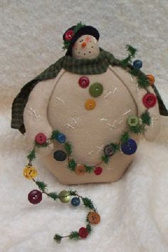 snowman with button garland