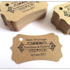 """Brown Kraft Fancy Rectangle Wedding Tags. These tags are unique addition to personalize your wedding favors. Tags measures 2.5"""" wide and 1.4"""" high, holes are optional for stringing."""
