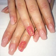 Nude gel polish with pink glitter gel accent nails.