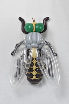 Masayoshi Matsumoto(previously here and here) doesn't twist up your average balloon animal creations. Instead, the Japanese artist produces larger than life beetle larva and spider crabs, creating latex masterpieces that blow away the simplistic balloon animals we've come to expect. Multi-colored a