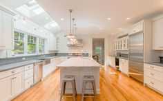 Skylights bring in tons of natural light making this a wonderfully bright and cheery kitchen featuring #CliqStudios shaker-style Dayton cabinets in painted white finish.