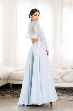 A powder blue, spaghetti strap top with raindrop beading is styled with a pair of delicate, wide-leg pants and a tulle, bell-sleeved bolero. Sarara Dress, Lehnga Dress, Sharara Suit, Stylish Dress Designs, Stylish Dresses, Simple Dresses, Dress Indian Style, Indian Dresses, Indian Outfits