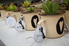 Using tin enamelware mugs for favors or decorations adds a sweet rustic touch to your wedding style.