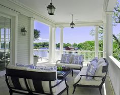Can a porch get any more perfect than this? Stunning views, architecture and patio furniture. I also love the pillows!