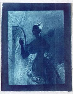 An experimental cyanotype of an engraving of a lady with a harp, by Sir John Herschel (1792-1871), 1842. Herschel invented the cyanotype or 'blueprint' in 1842, employing iron  salts (ferric ammonium citrate and potassium ferricyanide) which produce  Prussian blue under the action of light. It was a simple process to use  and required only water as a fixative. The cyanotype was the only first-generation photographic technique to find any lasting use.