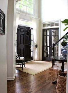 entryway, foyer, landing zone, entry table, seating, window, french doors, warm wood floors, Inviting