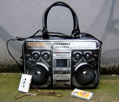 Boombox Handbag  Comes with detatchable, extendable shoulder strap. Zip up top. Fully lined with small inside pocket. [link]