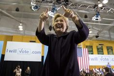 Hillary Clinton points to supporters after speaking at a rally at Wayne State University. (Photo: Andrew Harnik/AP)