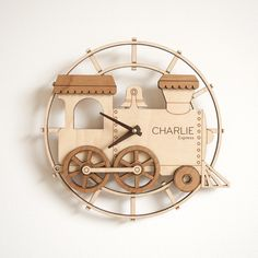 All aboard our new kids wooden train clock! Our cute train is personalized with your child's name on the engine.