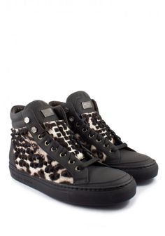 Philipp Plein - 'Leo Studd' Sneakers Black | Beautiful studded sneakers with fur inserts and small PHILIPP PLEIN logo applications. Comfort meets glamour in these shoes. Wear them with jeans and t-shirt. Complete the street style look with a baseball cap.