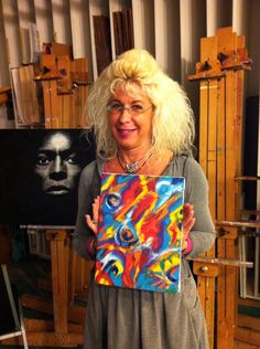 Karen Dew and a painting of hers, painted 2/1/15 at Tarnoff Art Center.