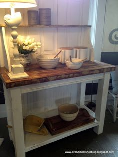 Would this work between the cabinets and the fridge?  Would the microwave fit on the top shelf? Bakers rack styled cabinet made from old door