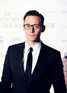 No, no, no, no!! THIS is not fair.  It's bad enough that Tom Hiddleston is perfection now you go and slap on a pair of glasses on him.  Is the universe trying to make me internally combust or something?  It's true, it really is...the universe DOES hate me.  Swoon!!!