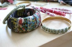 T-shirt bracelets. Really like this idea because you can purchase these things on the cheap at a thrift store & make so many variations!