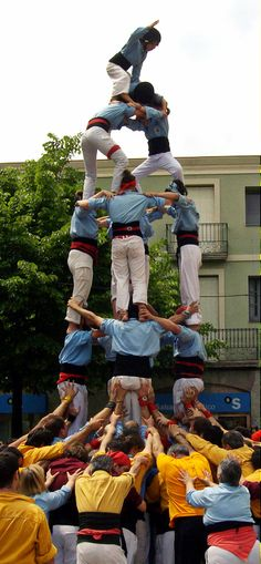 A castell is a Human Tower built traditionally in festivals at many locations within Catalonia, Spain.