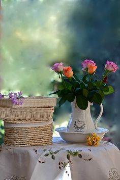 Garden table with flowers and baskets