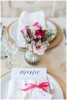 Destination wedding table centrepeices. Greek island wedding with cut glass vases and pink and olive details