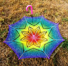 https://flic.kr/p/dbzA2p | Crochet Umbrella - Solaster Rainbow Crochet Lace Parasol | Made of sewing thread this SUNbrella is pretty lace weight. I choosed a star shape to modify and created as blended as possible for showing better the gorgeous motif of this vintage star doily pattern.  Colors are going from pink to purple accross red, orange, yellow, neon green, teal and blue (unfortunately my new camera doesn't seem to like violet shades at all so it's not that clearly visible on…