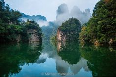 Baofeng Lake's crystal clear waters surrounded by sandstone pillars make a classic Chinese landscape. Best to be in the first boat of the morning to see the waters without ripples. It is also home to a giant salamander that can grow 2 meters long and weigh upwards of 50k. Saw one only in the museum.  #baofeng is China's first #Nationalforestpark #Zhangjiaji #Nationalpark #Forest #wulingyuan #nationalforests @thephotosociety @natgeo @natgeocreative by yamashitaphoto