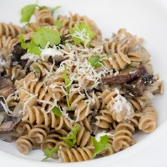 Rotini with Portobello Mushrooms, Caramelized Onions, and Goat Cheese. Made this last night w/o onions but plus spinach and zuccini and it was phenomenal!!!