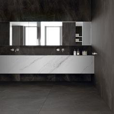 #Baños #modernos. #porcelánico #Storm de #Inalco, actualiza la clásica #piedra begra con vetas blancas.