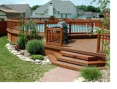Wraparound deck with gate and nice landscaping