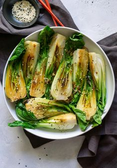 Quick and easy sautéed Baby Bok Choy with garlic and sesame seeds, made in less than 10 minutes. Serve this side dish alongside your favorite protein! Healthy Eating Recipes, Vegetarian Recipes, Cooking Recipes, Ww Recipes, Side Dish Recipes, Vegetable Recipes, Tasty Dishes, Food Dishes, Bok Choy Recipes