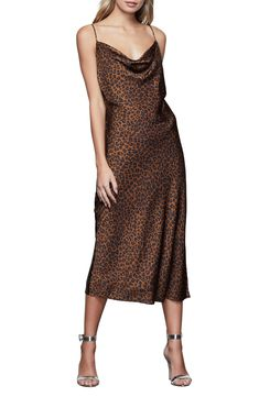 Date night is calling in this slinky, satiny slipdress styled with chic leopard spots and a drapey cowl neck. Style Name:Good American Leopard Slipdress (Regular & Plus Size). Style Number: 6065344. Available in stores.