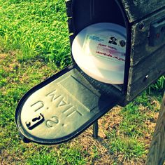 Toss a frisbee into the mail.