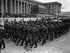 Staff officers and officer-scholars of Mongolian military academies marching through Sukhbaatar Square in Ulaanbaatar at the 1953 Mongolian Revolution Day Parade.