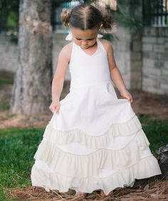 Take a look at the Oopsie Daisy Cream Cupcake Halter Dress - Toddler & Girls on #zulily today!