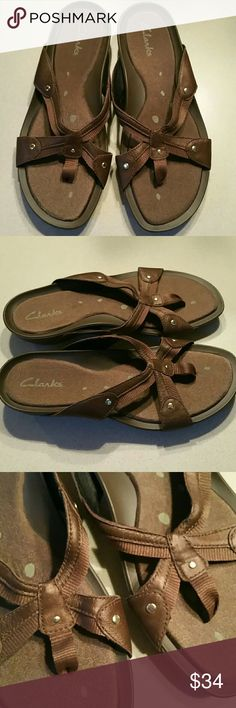 """Clark's rubber soled leather sandals Size 7.5 These are new, never worn. Very cool. Look a little like Tevas. They are canvas thong with dk. Brown leather trim. Super comfy, cushioned soles. Cute as ever. Measures approx. 10"""" in length. New condition, no wear. Size 7.5 Clarks Shoes Sandals"""