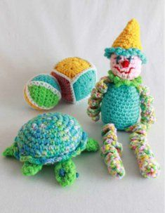 "PA874 Quick and Easy Toy Set Crochet Pattern- Using a double strand of worsted weight yarn and these quick and easy to make crochet patterns you can crochet delightful treasures to be enjoyed by mom and baby alike. Crochet pattern includes Tommy Turtle, Clancy Clown, Ball and Block. Skill Level: Easy Size: Turtle: about 9""; Cube: about 4 ½""; Ball: about 13"" around; Clown: about 11"" from Base to Tip of Hat."