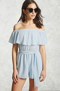 A crepe romper featuring an off-the-shoulder neckline, a flounce layer forming the short sleeves, a woven underlay, and an elasticized waist with a self-tie sash.