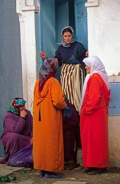 Morocco.Chefchaouen.Rif Mountains.Women in colourful Djellabas