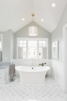 The master bathroom features a classic grey and white color scheme. Paint color is, once again, Benjamin Moore Stonington Grey . Freestanding tub is Victoria & Albert Toulouse Free Standing Tub. Bathroom Blinds, Bathroom Spa, Grey Bathrooms, Beautiful Bathrooms, White Bathroom, Small Bathroom, Master Bathroom, Bathroom Ideas, Cape Cod Bathroom