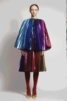 Raincoat. Good design. I believe what inspired this design are rainbows. The colors, from top to bottom are cool tone blue to a mixture of a purple/magenta mixtures. Also, I believe that the designer was inspired by rainbows, thinking of the sky falling in rain, creating rainbows.