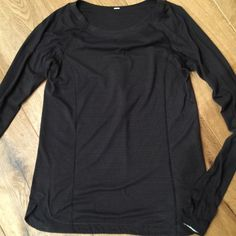Lulu black with wine stripes top. Size 4 Worn and washed once. lululemon athletica Tops