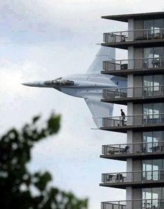 The undoctored picture was taken by Detroit News photographer Steve Perez on 12 July 2009. The Navy F/A-18 Hornet from Oceana Naval Air Station in Virginia Beach made a scheduled flyover to entertain crowds along the Detroit River that were there to watch the American Power Boat Association Gold Cup powerboat races. Just as the fighter turned sideways and flew past the apartments, Perez took this photograph.