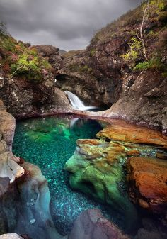 Waterfall with magic clear water pool in Scotland.