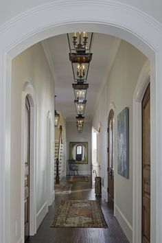 """""""Those are Vaughn lanterns from England. All of the other lighting was custom designed. The entrance has a long hallway so I felt that rhythm with the chandeliers would be interesting."""""""