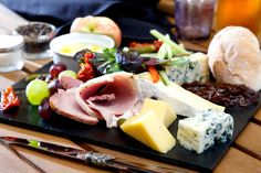 Rich cheese platter with diverse flavour options provided at the Compass Inn Dining