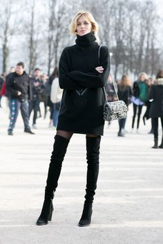 Anja Rubik is chic in a sweater dress and thigh-high boots.
