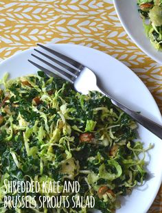 Shredded Kale and Brussels Sprout Salad - We can't get over how good this salad is! Shredded kale and Brussels sprouts with crunchy almonds, a little bit of cheese and a delicious dressing made this salad disappear fast. You seriously need to try this!