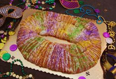 Mardi Gras is on March 4th this year and are you planning to celebrate? Pamela has a gluten-free version of the New Orleans style yeast cake that is traditionally decorated with yellow (or gold), purple and green, and colored glazes or sugar sprinkles.