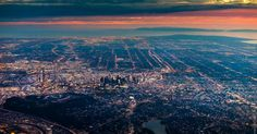 Los Angeles, Calif., from above. Vincent Laforet straps into a full-body harness and leans over the edge of a helicopter to take the images.