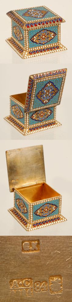 A Russian gildedd silver and cloisonne enamel box, Gustav Klingert, Moscow, circa 1894. The box is decorated on all sides with a shaped cartouches surrounded by turquoise enamel bands of white enamel beads. The flared base and cover are worked in a red and cobalt geometric pattern within additional bands of white beads.
