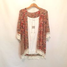 Lacy Floral Kimono SIZE MEDIUM LEFT! This kimono is so on trend for the spring and summer! Your search for the perfect kimono is over! Fits loose- I own the large and I'm a 12/14 so it's a great staple piece for your wardrobe (as shown in second pic)! Goes with just about everything and has great colors for spring! Tops