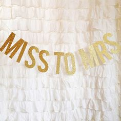 GOLD GITTER MISS TO MRS LETTER BANNER! How cute is this for a bridal shower or bachelorette? Letters are strung on gold glitter twine that